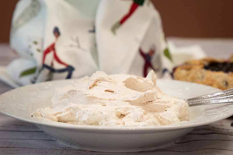 Pumpkin Spiced Whipped Cream adds fall flavors like cloves & cinnamon to a tasty topping. Great on pies, cakes, pancakes, hot drinks & more.