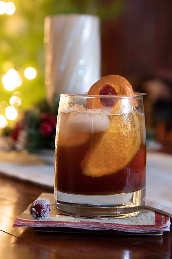 This Wisconsin Old-Fashioned recipe uses pomegranate molasses instead of cherries with a cranberry garnish for a holiday flair. Cheers!