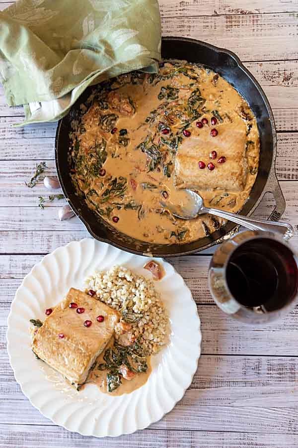 One Pan Tuscan Salmon starts with healthy salmon then adds spinach, tomatoes and Italian seasoning, plus a creamy delicious sauce.