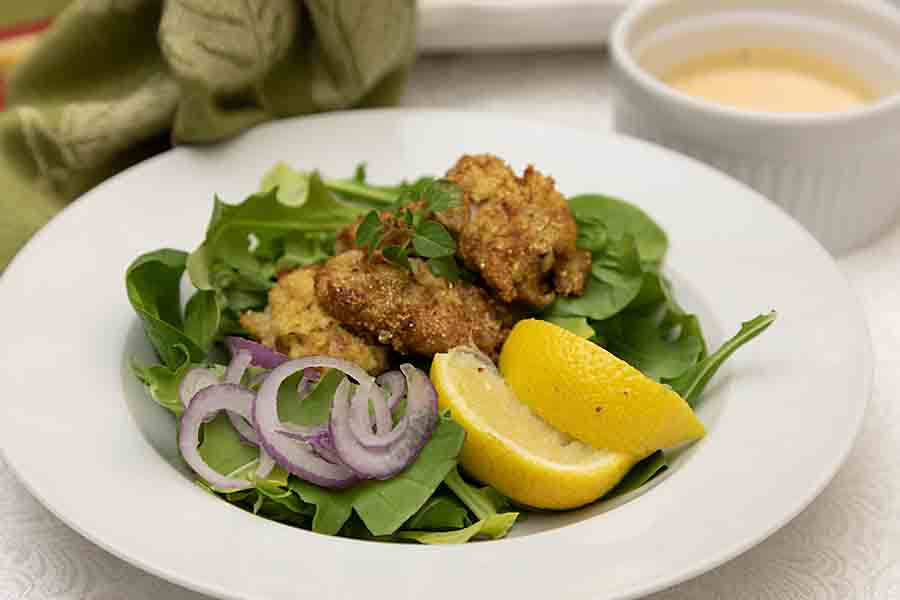Spicy and crunchy with a taste of the Gulf, New Orleans Fried Oyster Salad is an easy and delightful way to armchair travel!
