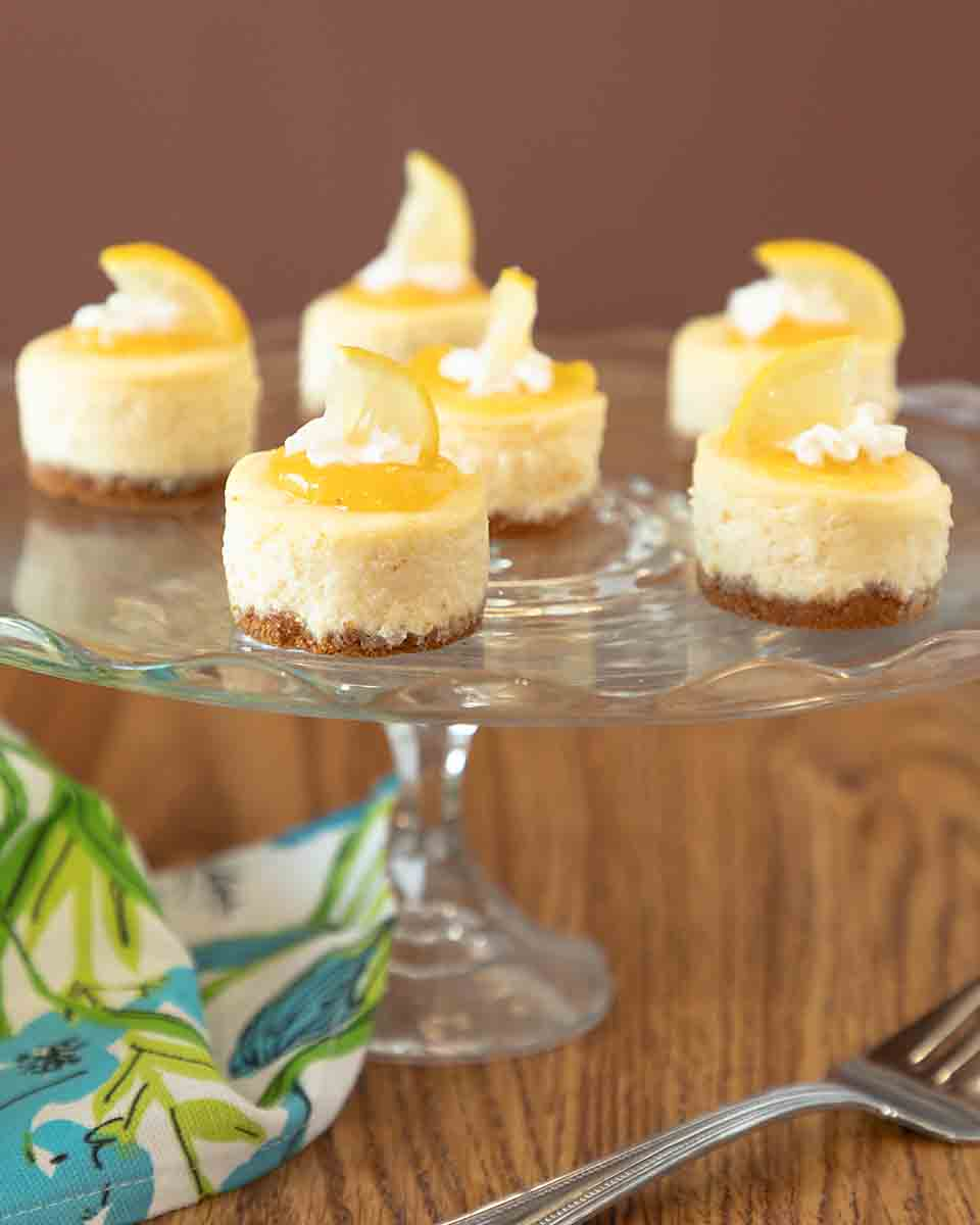 These Lemon White Chocolate Mini Cheesecakes have a creamy lightness & bright lemon tang for a fun & special dessert. Gluten-free option!