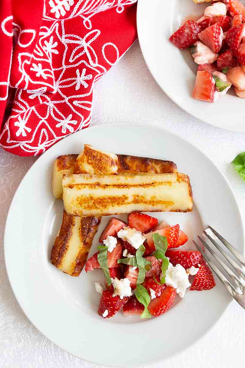 Finnish Bread Cheese with Strawberry Salsa serves up warm, soft slices of cheese topped with fruit salsa and a honey balsamic vinaigrette.
