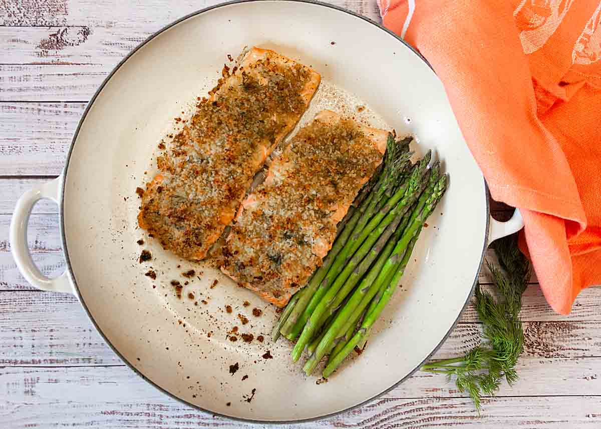 Horseradish Crusted Salmon with Asparagus is healthy, moist and flavorful. Even better it can be made in minutes in a single pan!