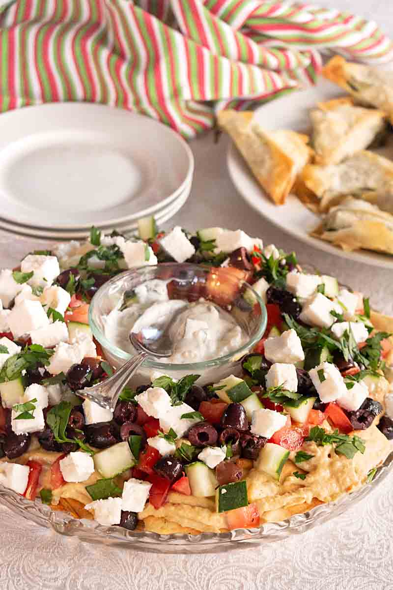 Middle Eastern Nachos are a fun appetizer, snack or light dinner with pita chips, hummus, feta, olives and more.