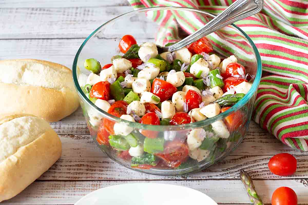 Simple, elegant, & tasty Asparagus Caprese Salad combines asparagus, fresh mozzarella, tomato & basil for a yummy 5-ingredient vegetable side!