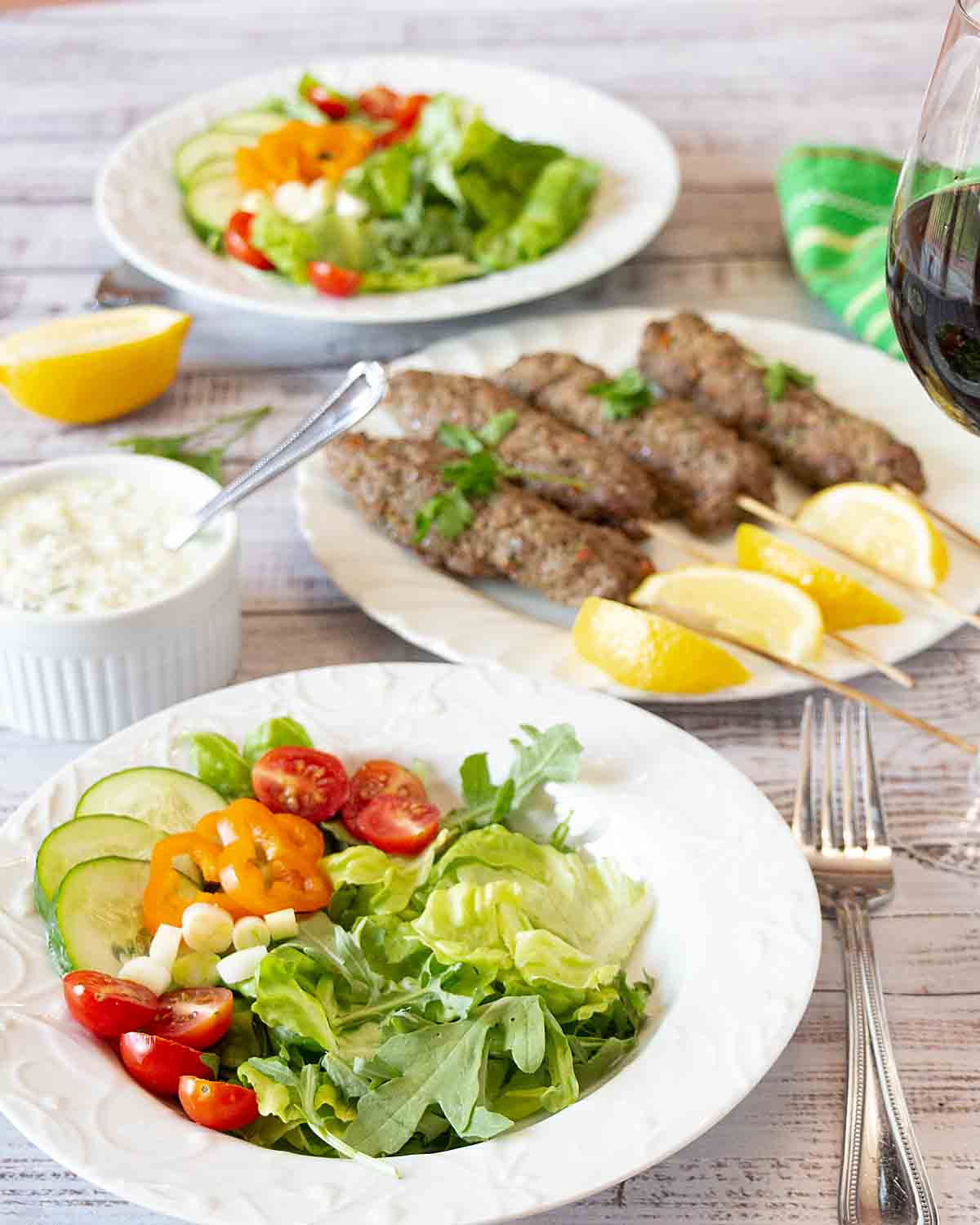A green salad topped with spiced beef sausage kebabs, Kefta Salad with Tzatziki Dressing is a tasty and unique main course salad. Just add pita.