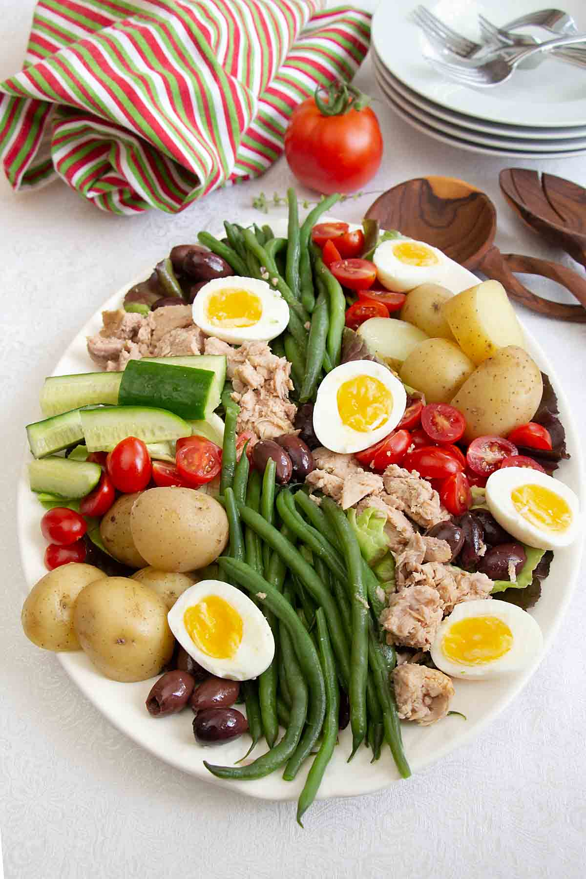 Tender butter lettuce topped with tuna, green beans, tomatoes and more, the Nicoise Salad is as healthy as it is tasty!