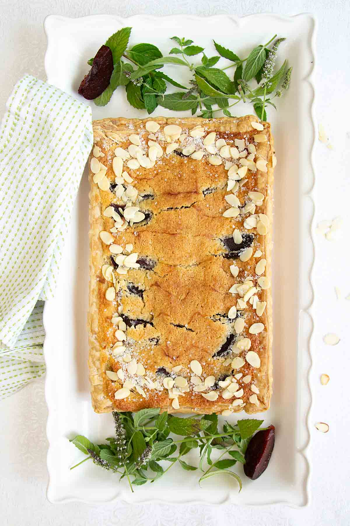 With ripe plums and rich almond cream atop a flaky crust, plum frangipane tart is a beautiful dessert that's super easy to make!