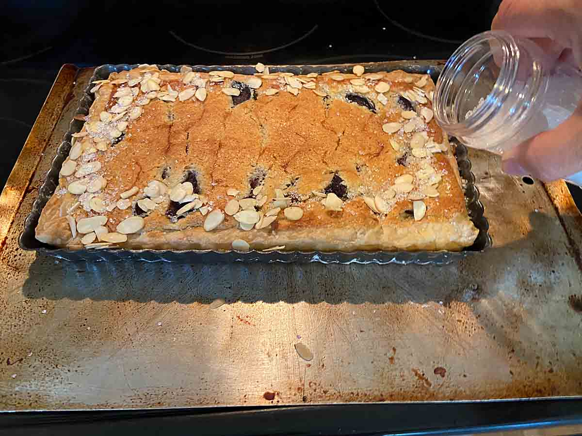 sprinkle edges with sliced almonds and sugar