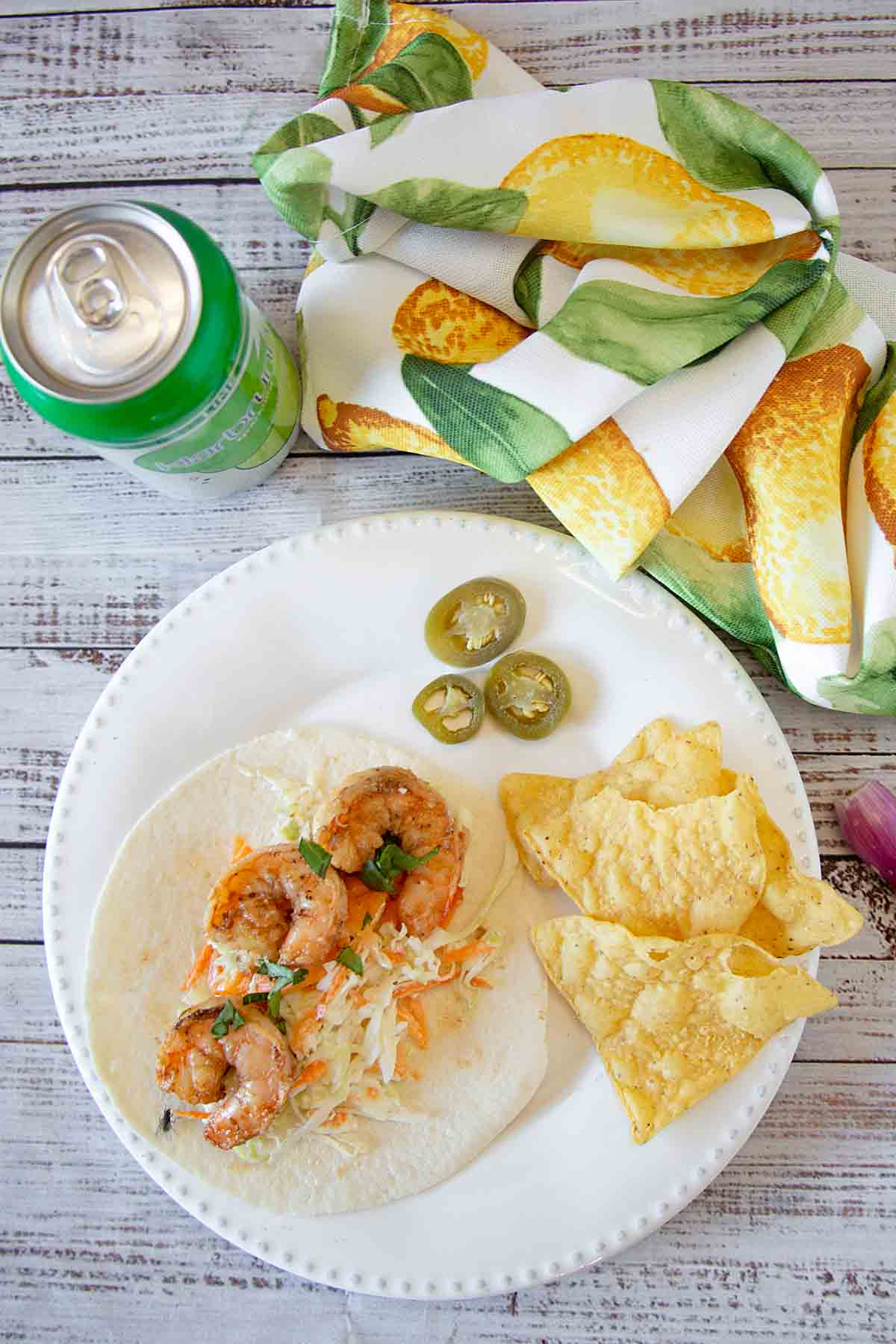 Seasoned shrimp, paired with fresh coleslaw and your favorite toppings, makes Grilled Shrimp Tacos a fun and tasty lunch or dinner.