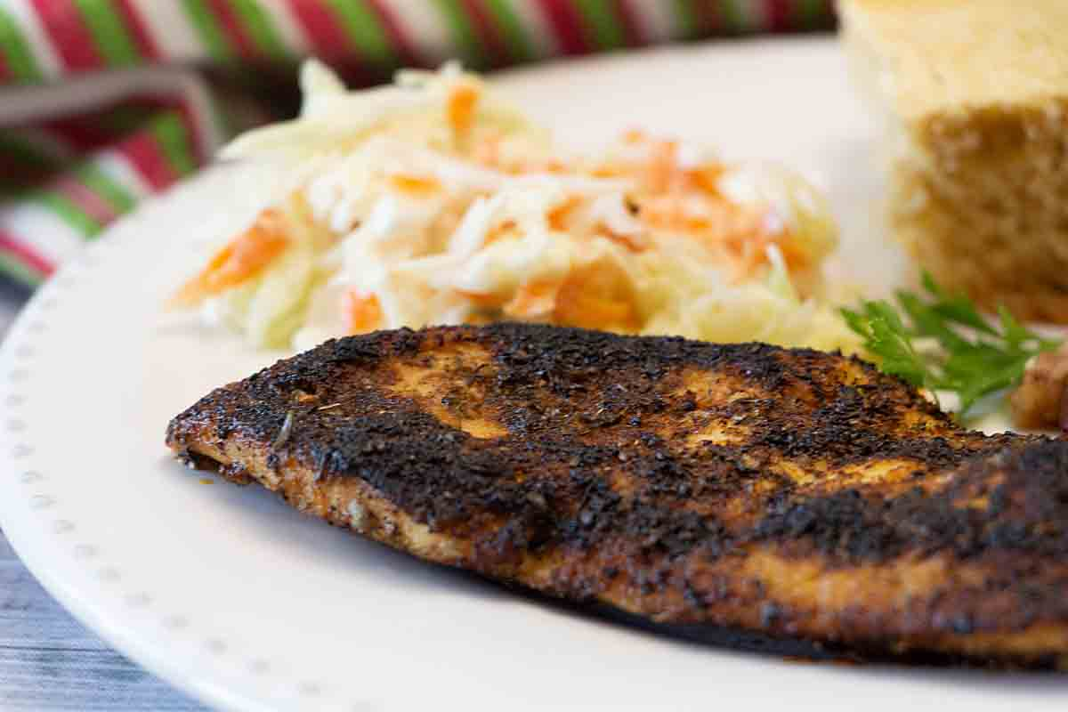 Blackened Chicken is a spicy and flavorful main dish from Cajun country. Add simple sides like coleslaw and corn bread for a quick & easy dinner.