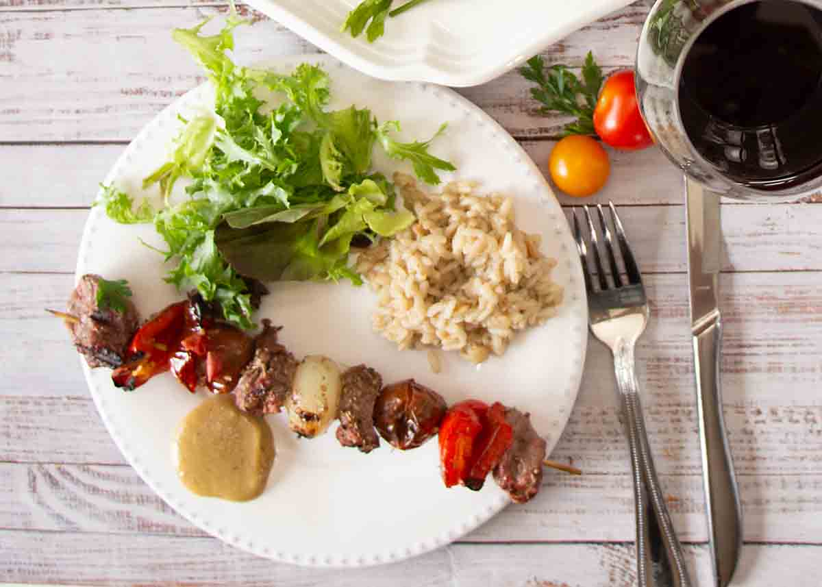 No Marinade Lamb Kabobs combine juicy lamb, ripe peppers, tomatoes, onions and tahini sauce for a tasty, healthy dinner!