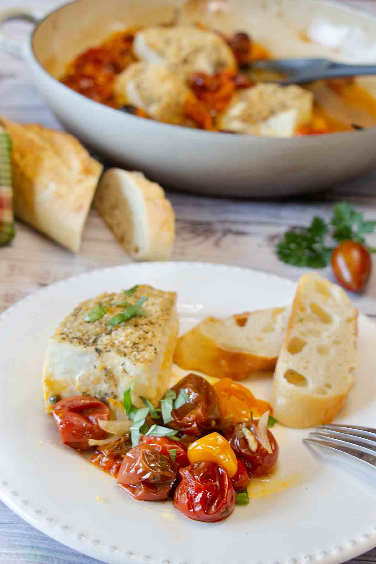 With flaky fish on a juicy and flavorful mix of cherry tomatoes and peppers, One Pan Baked Halibut is an easy, healthy weeknight dinner.