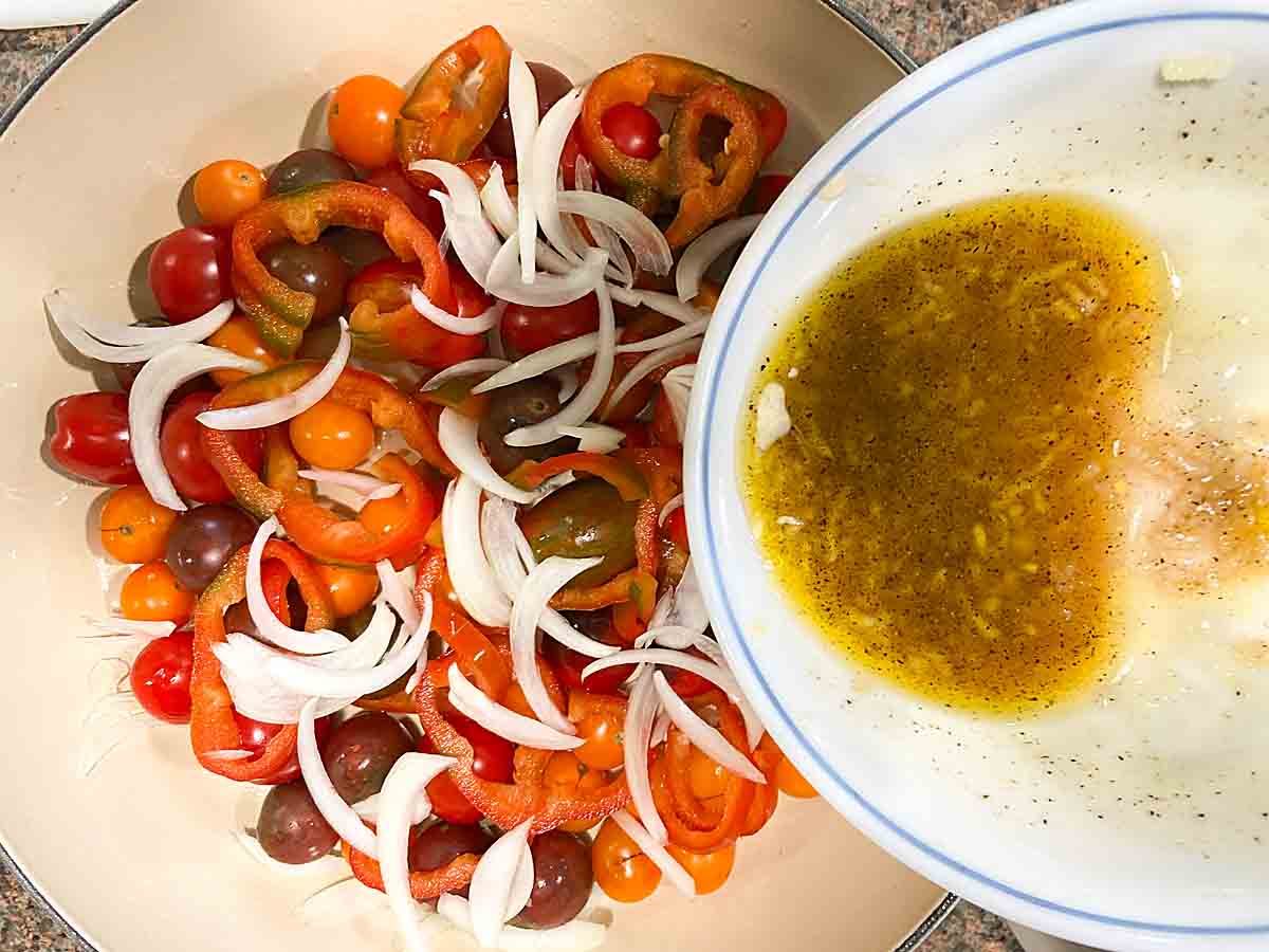 Top sliced veggies with dressing