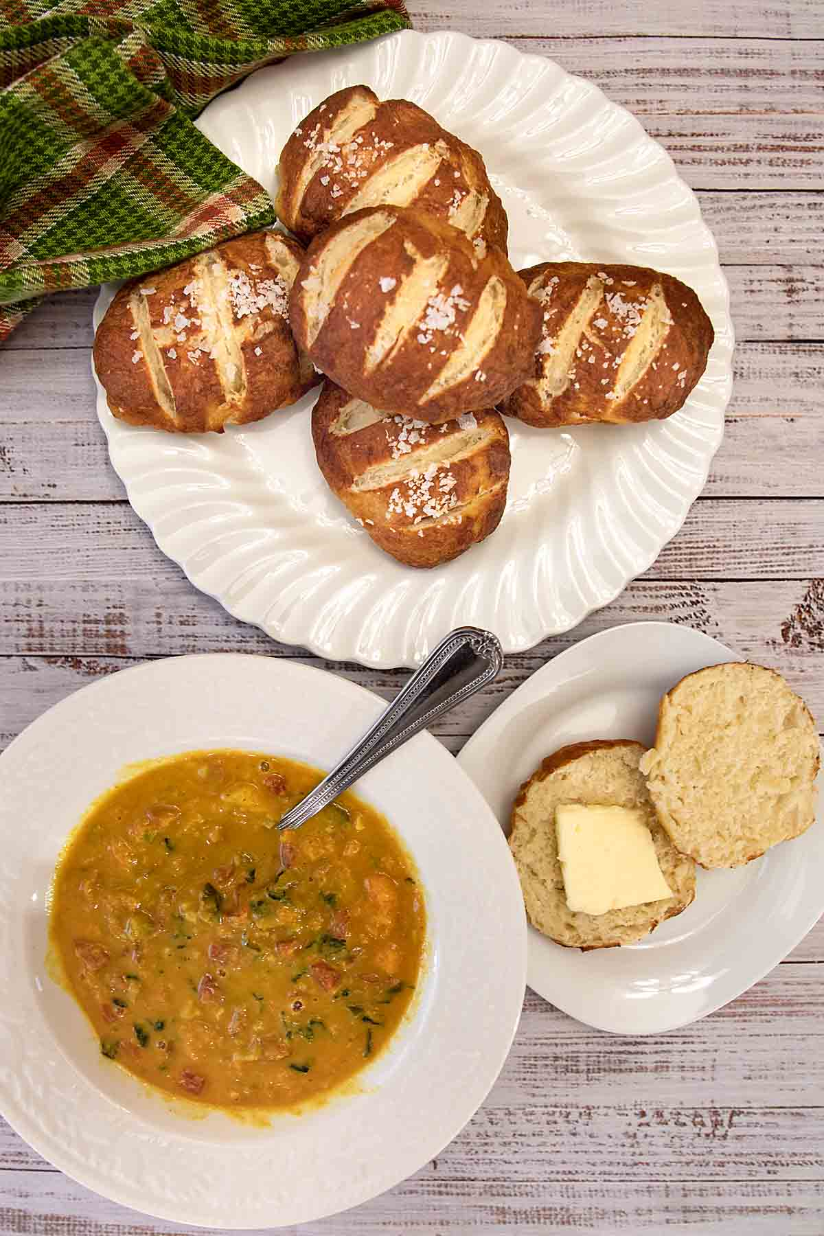 Homemade Pretzel Rolls are chewy, salty and delicious. Use as a sandwich or hamburger bun or as a fun side with lunch or dinner.